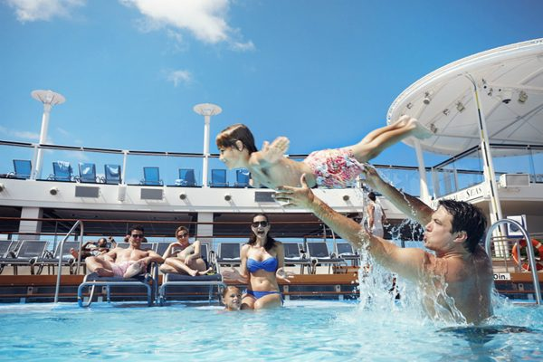 Children jumping into the pool on-board Empress of the Seas