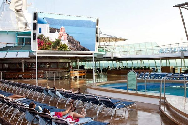 Outdoor film screen by the pool on-board Grandeur of the Seas